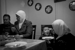 Eman feeds her son, Hassan, a traditional Syrian dish of Maqlooba during dinner in their Brooklyn apartment. Michael Appleton/Mayoral Photography Office