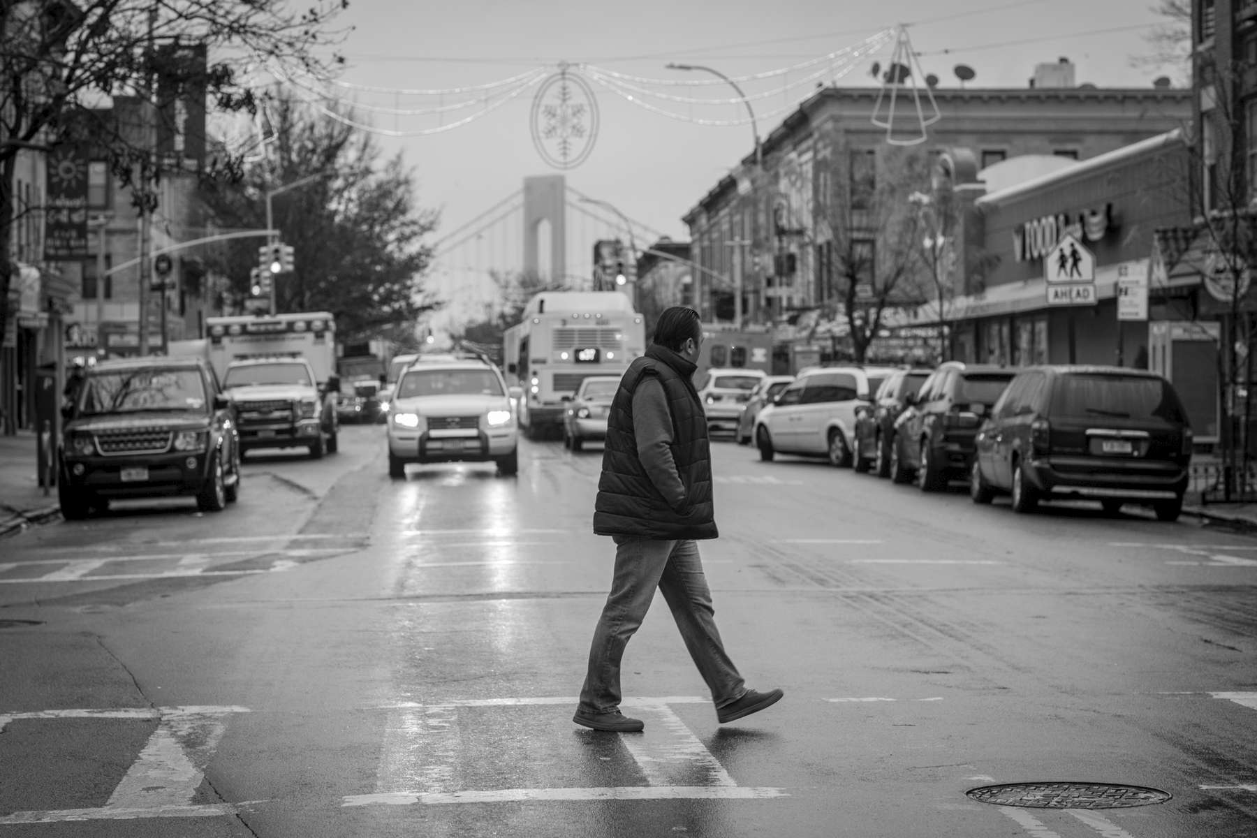Abdullah Ferdous walks in Brooklyn on his way to a food market where he is installing appliances and lighting. Michael Appleton/Mayoral Photography Office