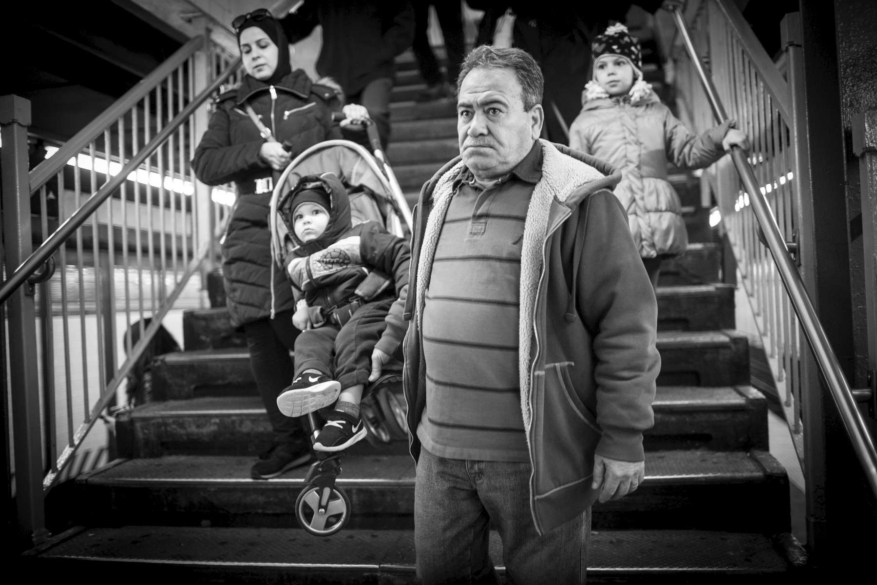 Hassan Ferdous carries his grandson, also named Hassan, with Eman as they travel to Downtown Brooklyn to go shopping and visit the Brooklyn Heights Promenade. Michael Appleton/Mayoral Photography Office