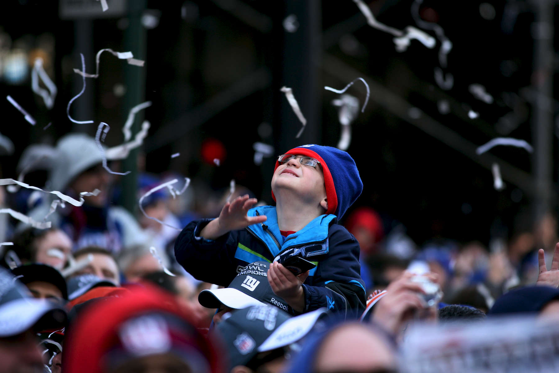 CJ Fortunes, 5, from Old Bridge, NJ, joins the crowds on Broadway in downtown Manhattan for the New York Giants Super Bowl victory parade on Tuesday, February 7, 2012.   (Michael Appleton for The New York Times)  METRO YEAR IN PHOTOS FOR NIKO
