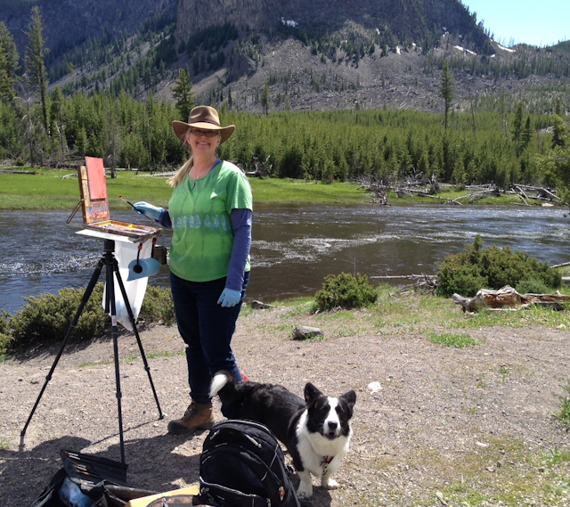 The artist, S'zanne Reynolds, painting in Yellowstone with  canine companion, John Singer Sargent.
