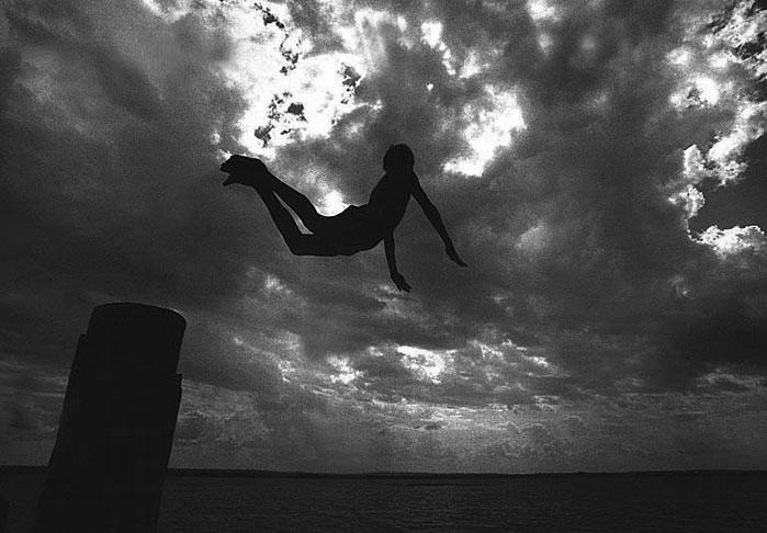 A boy diving into the Tapajos River in the Amazon.Aveiro, Brazil