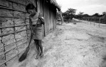 A girl cleaning outside her home inAvierovillage along the Tapajos River.