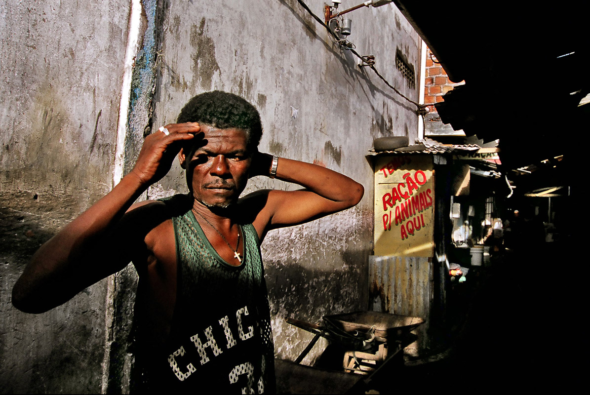 A worker in a back alley of a open market in Salvador.