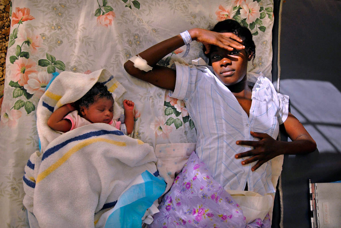 A young woman and her newborn baby resting in the general hospital in Port-au-Prince where earthquake victims where being treated.