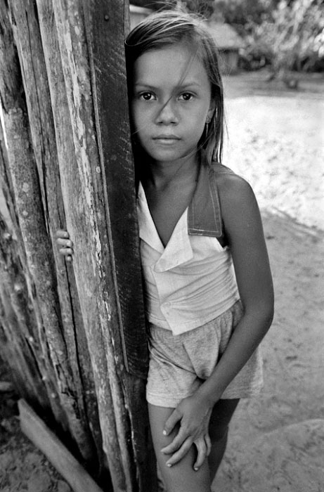 A young girl in front of her home in the Amazon.Boim, Brazil
