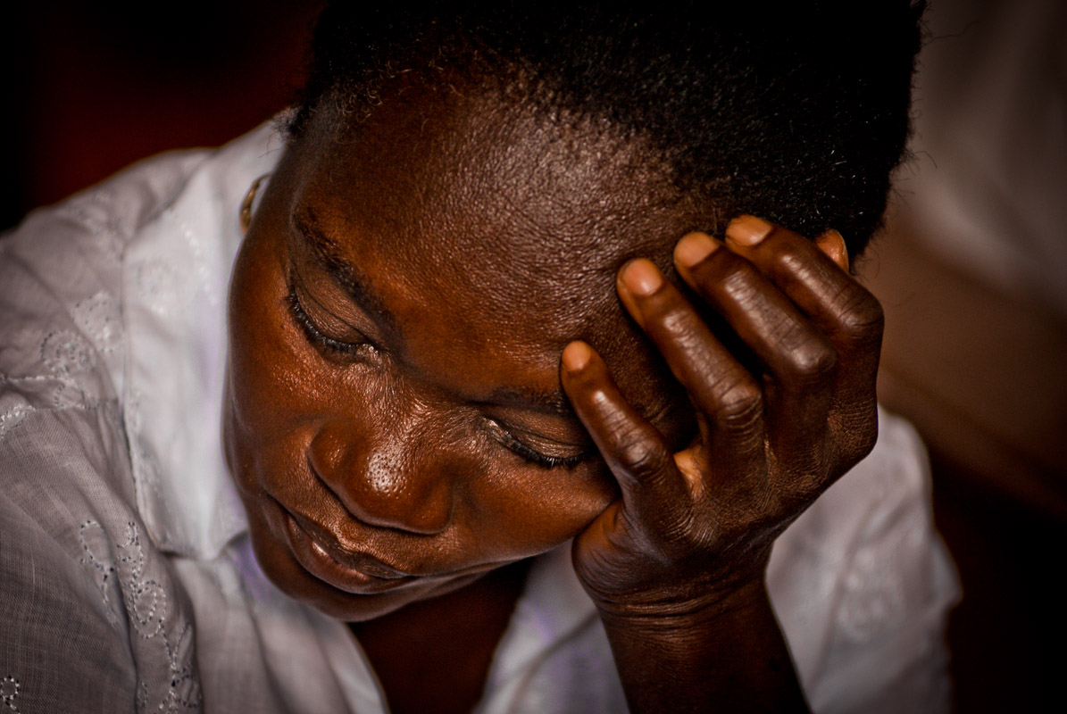 A woman praying during a mass in Cap-Haitian.