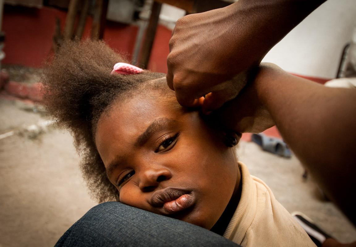 Lovely having her hair braided.Cap-Haitian