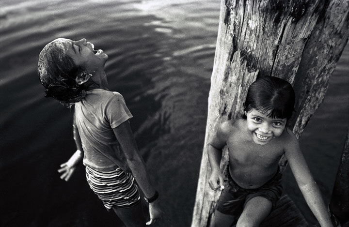 Two girls playing around at a dock along the Tapajos River.