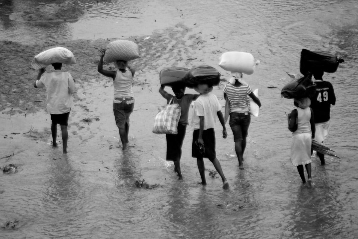 Women crossing the Massacre River to Dajabon, Dominican Republic