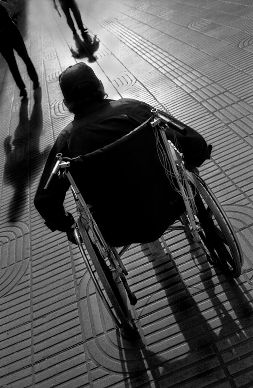 Man on a wheelchair at sunset in the Zona Colonial section of Santo Domingo, Dominican Republic