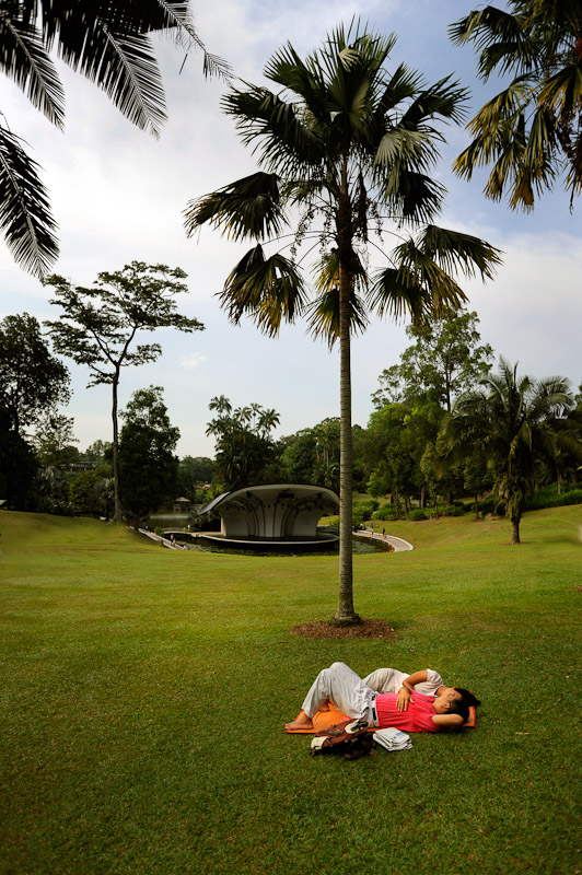 A couple resting in the Botantical garden in Singapore.