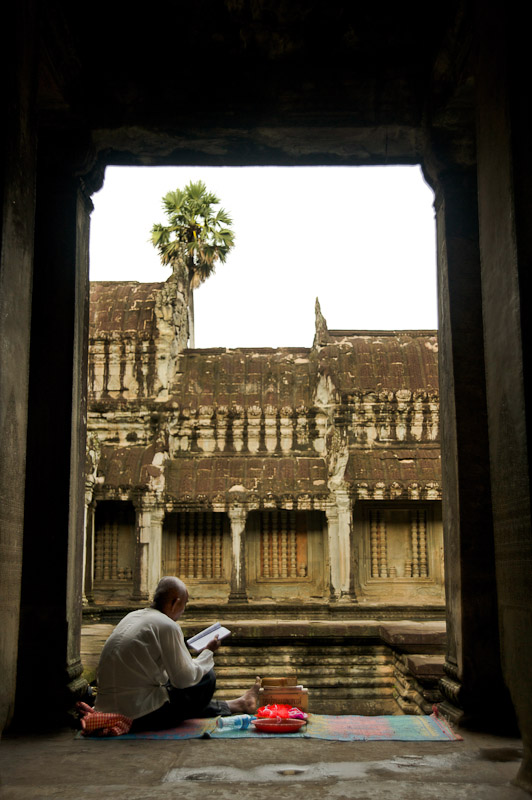 A monk reading in a temple in Angkor Wat, Cambodia.