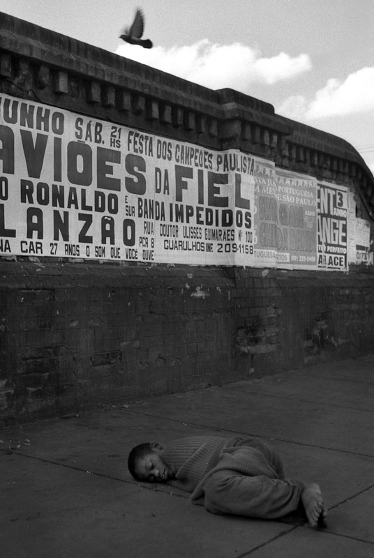 A child sleeping on a street behind a train station in Sao Paulo.