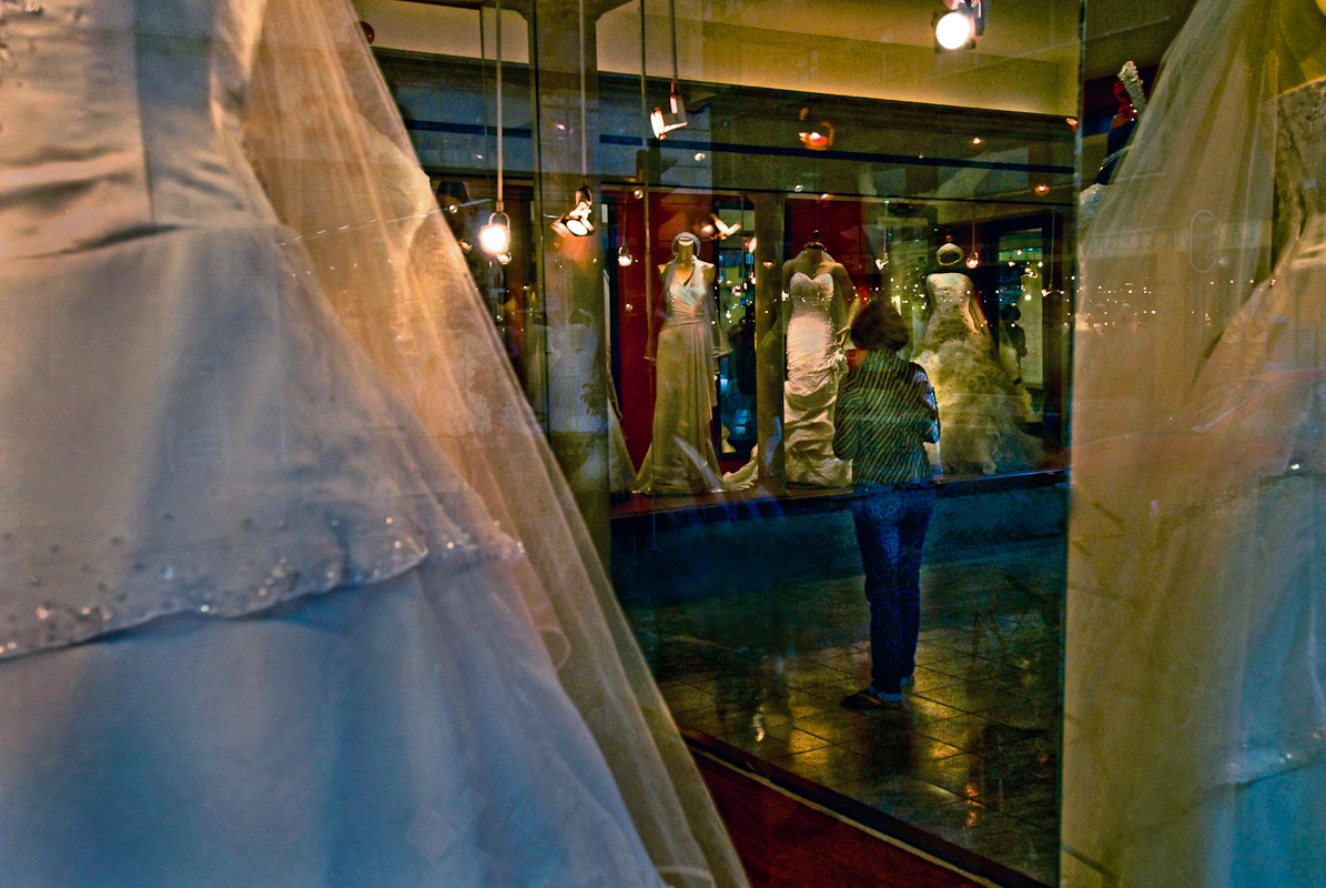 Mexico City, MexicoA woman looking at wedding dresses.
