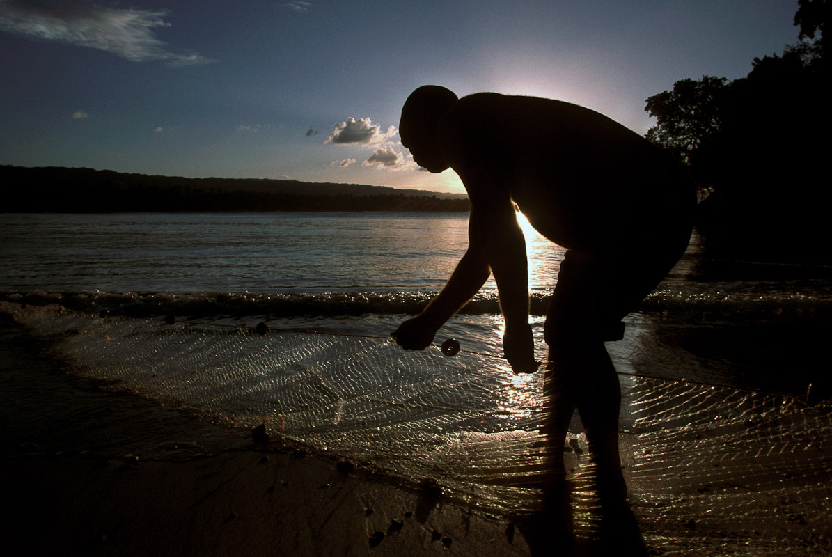 Fisherman pulling in his catch in Las TerrenasDominican Republic.