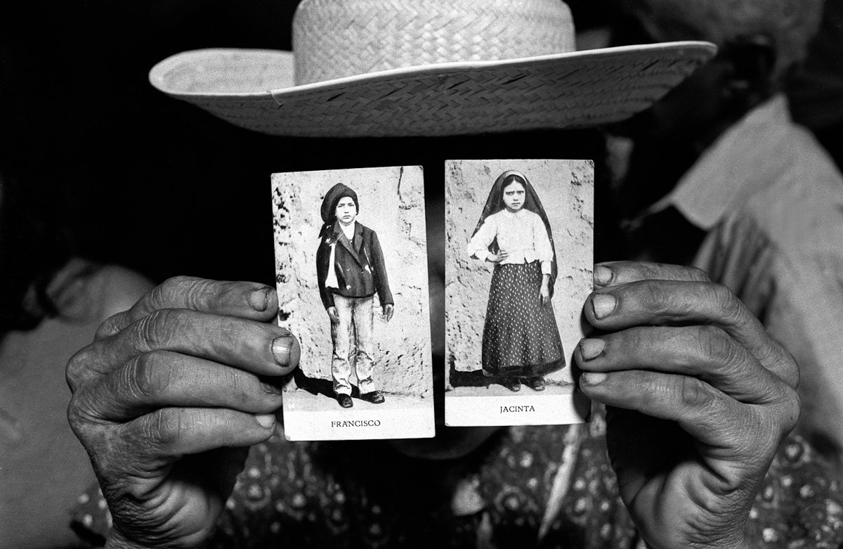 A pilgrim holding photographs of Jacinta and Francisco. Juazeiro do Norte, BrazilIn 1989, on the 72nd anniversary of the first appearance of Our Lady of Fatima, Pope John II officially recognized and beatified the herioc virtues of Francisco and Jacinta Marto. In late 1917, Jacinta and Francisco received apparitions of Our Lady at Cova da Iria, near Fatima, a city 110 miles north of Lisbon, Portugal.