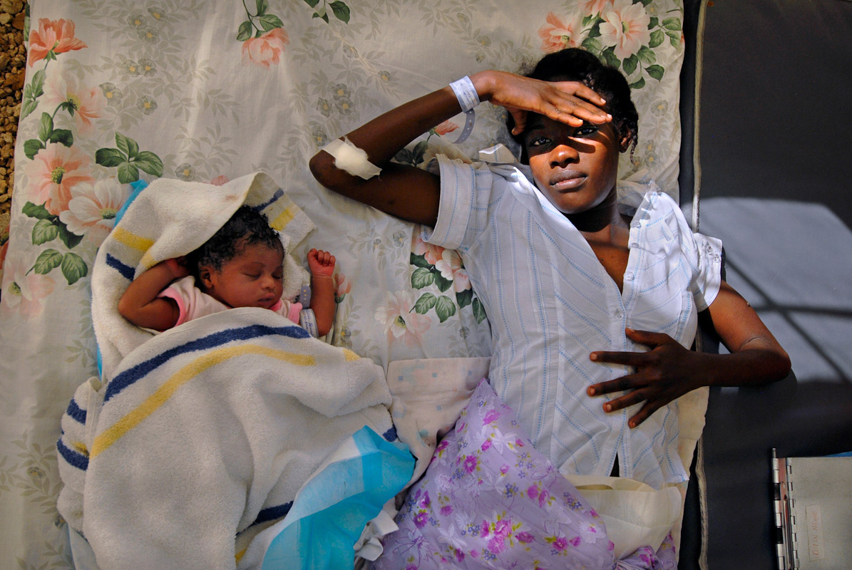 A mother and her newborn baby in a maternity tent at the General Hospital in Port-au-Prince.