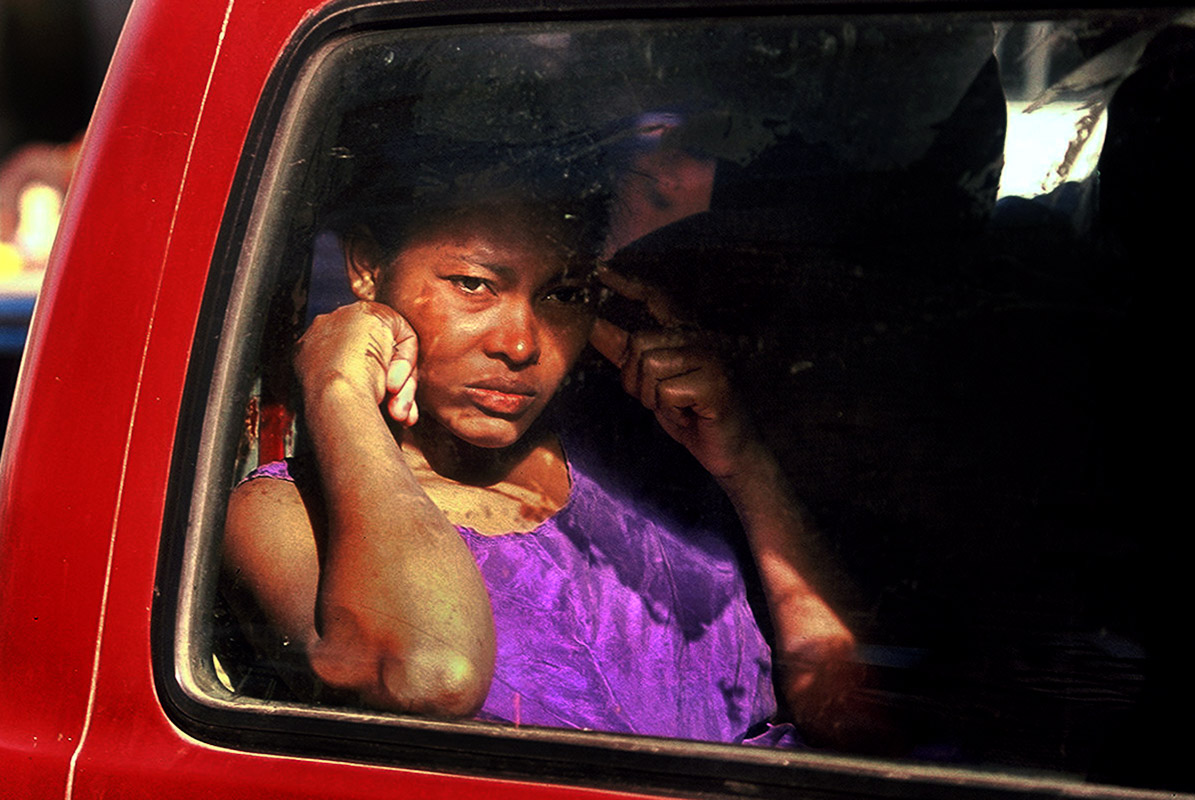 A woman sitting inside a mini bus in downtown Santo Domingo.
