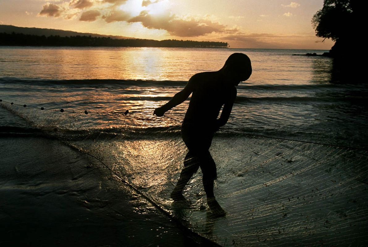 A boy pulling out a fishing net at Playa Bonito.