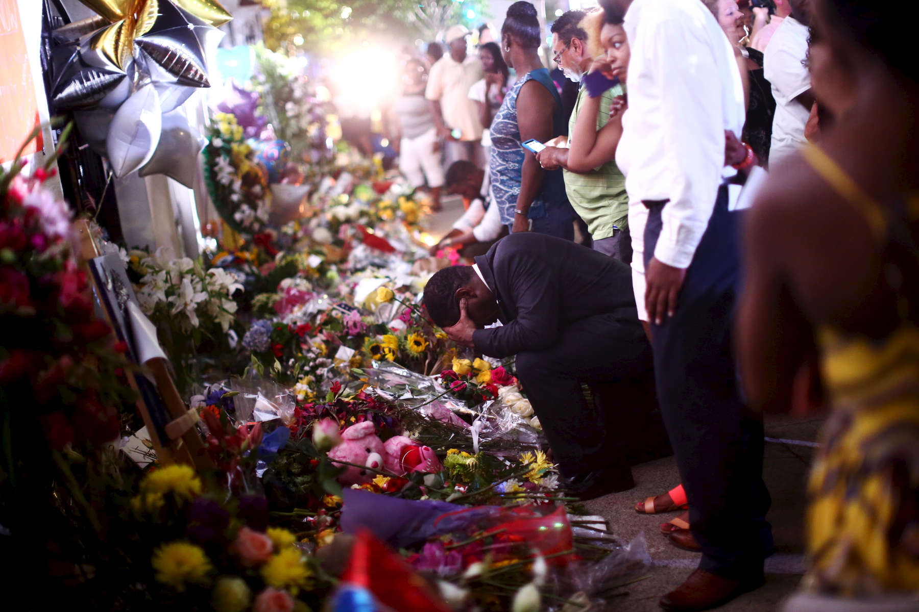 NAT *** Charleston, SC -- 06/19/2015 - A vigil was held on Friday at  College of Charleston TD Arena in in Charleston, SC. Afterward, people gathered, sang, and prayed outside of Emanuel AME Church.(Travis Dove for The New York Times)