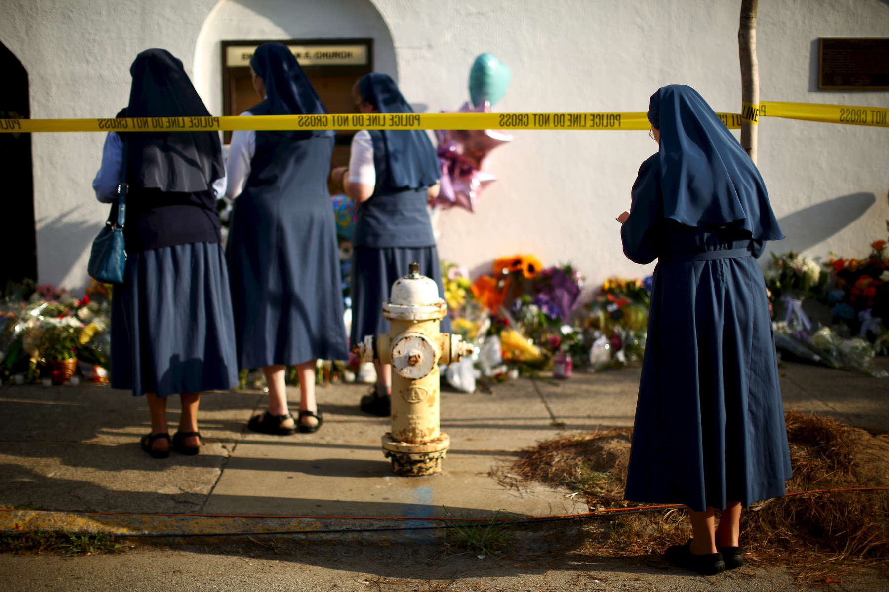 NAT *** Charleston, SC -- 06/19/2015 - Nuns prayed outside the Emanuel AME Church in Charleston, SC on Friday morning. Scenes from Charleston, SC after a gunman opened fire in a historic black church on Wednesday night.  ****DO NOT USE WITHOUT SPEAKING TO NATIONAL PHOTO EDITOR. HOLD FOR SUNDAY CHARLESTON STORY*****(Travis Dove for The New York Times)