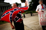 NAT ***Columbia, SC -- 07/06/2015 - Flag supporters outside the state house. South Carolina's legislature takes up the issue of removing the Confederate battle flag from the state house grounds on Monday.  (Travis Dove for The New York Times)