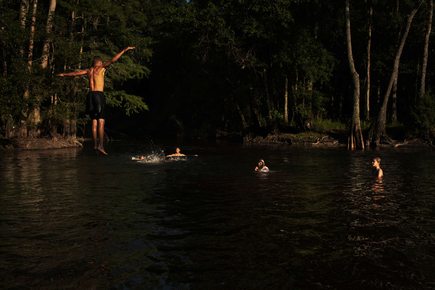 Maxton, NC A group of Lumbee Indians swim in the dark water of the Lumber River at a bend where one of their ancestors, Henry Berry Lowrie, is said to have fought off a local militia more than a century ago. The river is central to the creation story of the tribe and is at the core of Lumbee identity. (Travis Dove for The Washington Post Magazine)