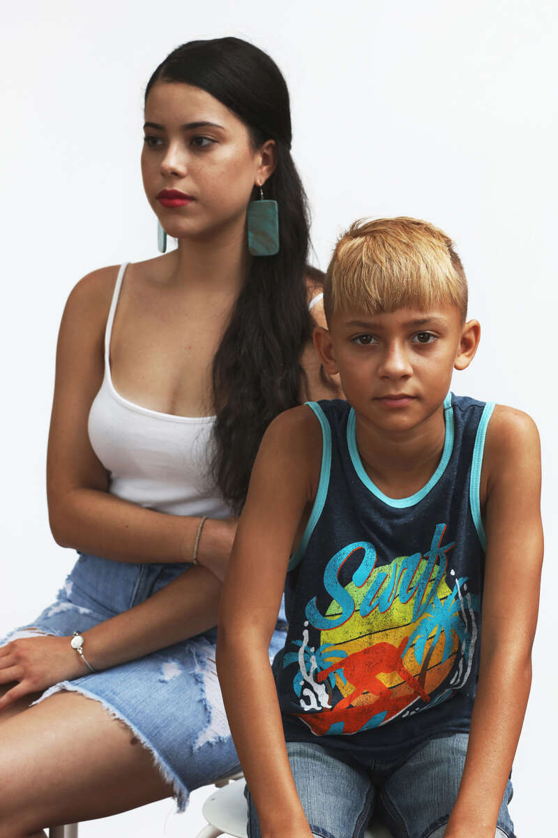 Cousins, Nola Graham (left) and Bryce Locklear pose for a portrait on July 7, 2018 in Pembroke, NC, USA.The Lumbee tribe of eastern North Carolina is comprised of a people who's native identity—however culturally rich—has been fought over for more than a century by a federal government that doesn't see them fitting neatly into any racial category.   (Travis Dove for The Washington Post Magazine)