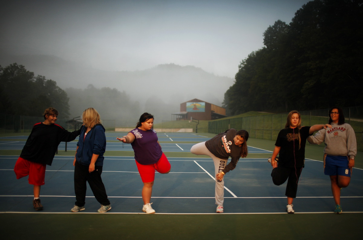 08/26/2011 *** Brevard, NCWellspring students are lead in stretching after their 6:30 AM morning walk.  Located in the mountains of North Carolina, Wellspring Academy is a boarding school for overweight children and young adults.  In addition to their regular classes, students learn to control their weight through a healthy diet, physical activity, and counseling.  (Travis Dove for NPR)