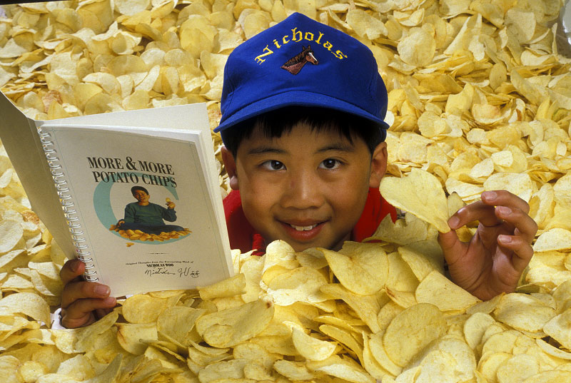 Shot on assignment for NATIONAL GEOGRAPHIC WORLD Magazine. A published author at age 10, Nicholas Woo's book was about a subject he really loved..... ..Potato Chips!