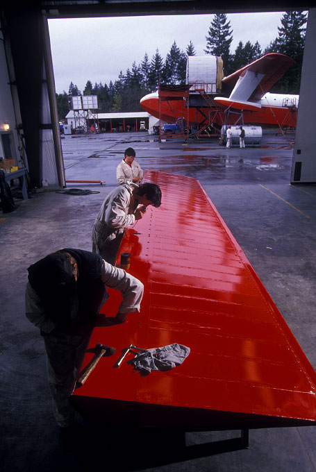 Shot on assignment for AIR & SPACE Smithsonian Magazine.  Workmen at the Sproat lake Flying Tankers aerial firefighting base on Vancouver, Island, B.C. make repairs to a wing flap from the one of the Martin Mars flying boats that is used to drop water on remote forest fires. The huge amphibious planes can deliver 7200 gallons in a single load.