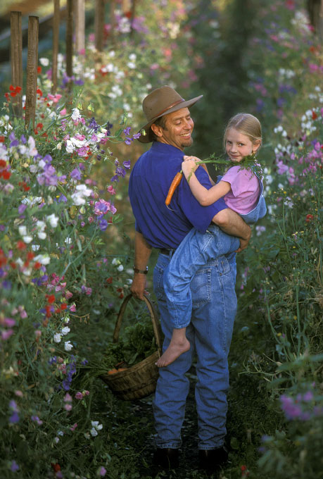 Shot on assignment for a cover for ORGANIC GARDENING Magazine. Dr. John Navazio is a world reknowned organic vegatable geneticist. He was photographed with his daughter at Joes Garden in Bellingham, WA.