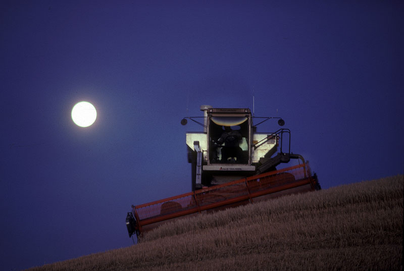 Shot on assignment for NATIONAL GEOGRAPHIC Magazine. A harvest moon rises behind a combine harvesting wheat in the Palouse farming region of northern Idaho.