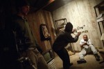 Director Ya'ke Smith frames a shot as cinematographer Lucas Millard looks on.