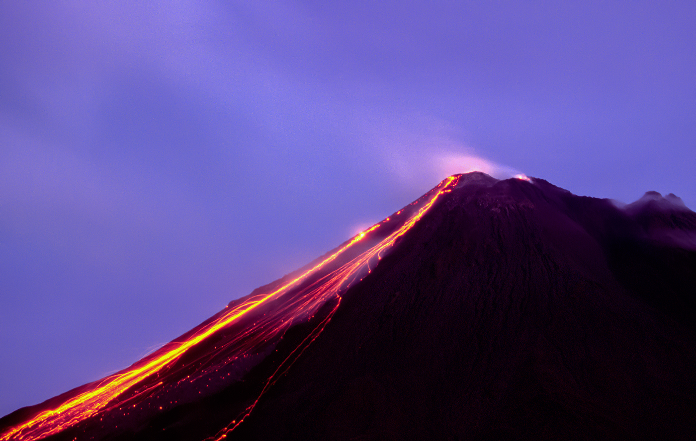 Lava flow under a full moon. Arenal, Costa Rica