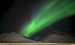 The aurora fills the night sky above Anaktuvuk Pass, Alaska.