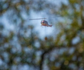 CalFire's Boggs Mountain Helitack moves in for a drop on a fire along Berryessa-Knoxville Road in northern Napa County, California.