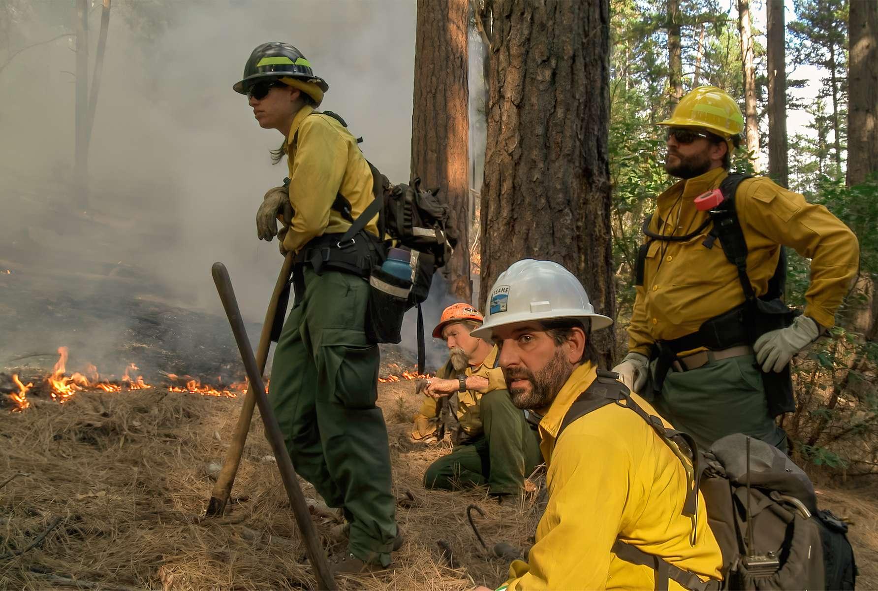 A fire crew keeps an eye on a prescribed fire above Weaverville, California.