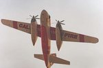 CalFire Tanker 100 returns to the Hollister Air Attack Base after making a drop on the River Fire in Monterey County.