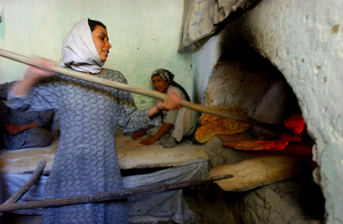 Farzana, 20, breadmaker at a women's bakery in Kabul, Afghanistan. This Bakery was founded by Massouda Jalal, the minister of Women's Affairs.