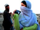 Farshta Kohistani, 19 years old photographer for UNAMA, photographing in a Kuchi camp outside of Kabul Afghanistan.