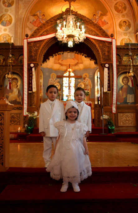 Three American Gypsy children being baptised together at a Greek Orthodox church in Queens, NY.