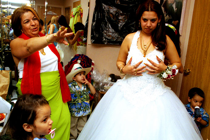 American Gypsy bride getting ready for her wedding ceremony with her mother-in-law in Queens, N.Y.