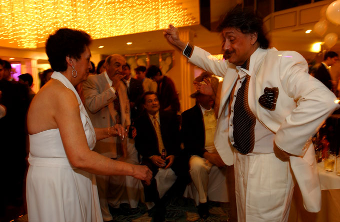 Lulu, daughter of Pete Costello, {quote}King of the Gypsies{quote} in N.Y.C.dancing with her husband,Waki, at the celebration of their grandchildren's baptism in Queens, N.Y.