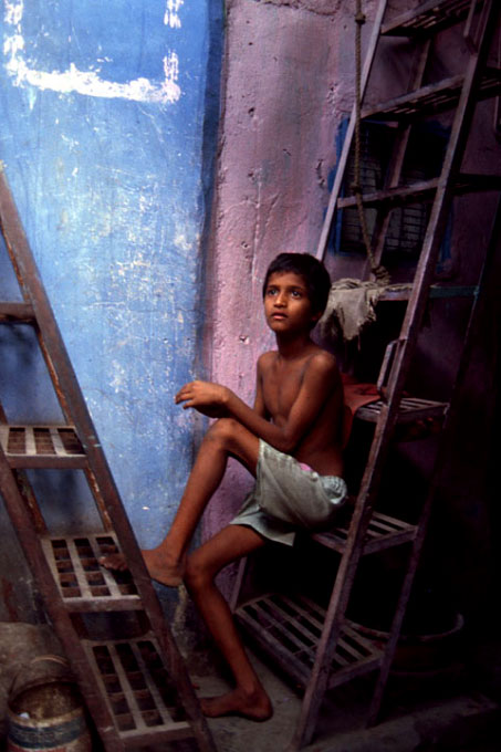 Young Indian boy rests in the streets of Calcutta, India