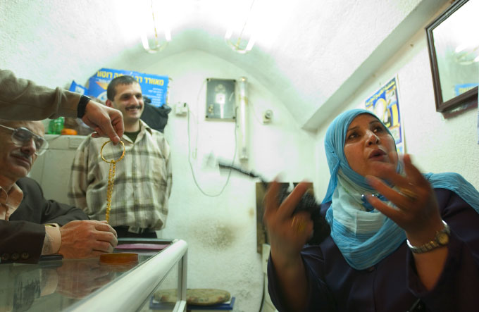 Palestinian women selling her wedding gold a the Gold Market in Gaza City.