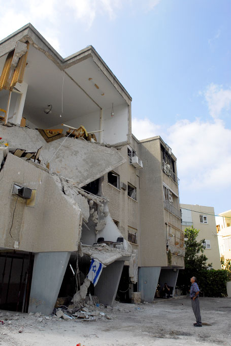Apartment building destroyed by Katyusha rocket in Haifa, Israel