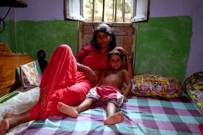 Sex worker and her child at the Sanagachi brothel in Calcutta, India
