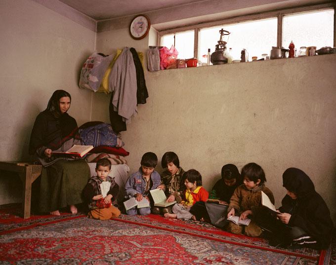 Mahmooda Hosseini, female Afghan Mullah, teaches children the Koran in her home in the Micrion neighborhood of Kabul, Afghanistan